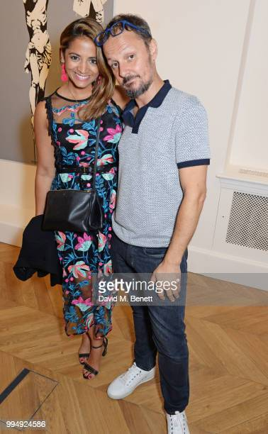 Katy Wickremesinghe and Jonathan Yeo attend the Bansky 'Greatest Hits 20022008' exhibition VIP preview at Lazinc on July 9 2018 in London England