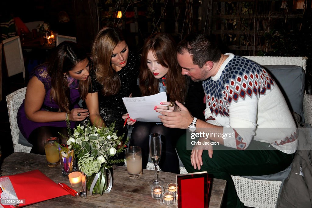 Katy Wickremesinghe, Zoe Hardman, Angela Scanlon and Nick Ede take part in the Vodafone Fashionable Pub Quiz at Shoreditch House on November 21, 2012 in London, United Kingdom. As Principal Sponsor of London Fashion Week, the quiz celebrated Vodafone's commitment to British Fashion.