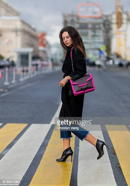 Katy Yanok wearing Gianvito Rossi shoes Koton jeans a pink Chanel sweater Fendi coat Alexander McQueen bag on October 15 2016 in Moscow Russia