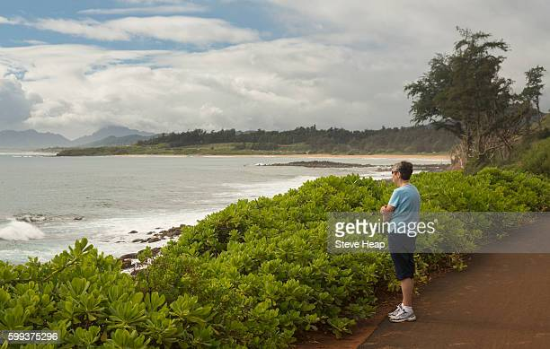 Kauai, Hawaii, USA - Senior woman admiring view on the Kapaa bike path on the East coast