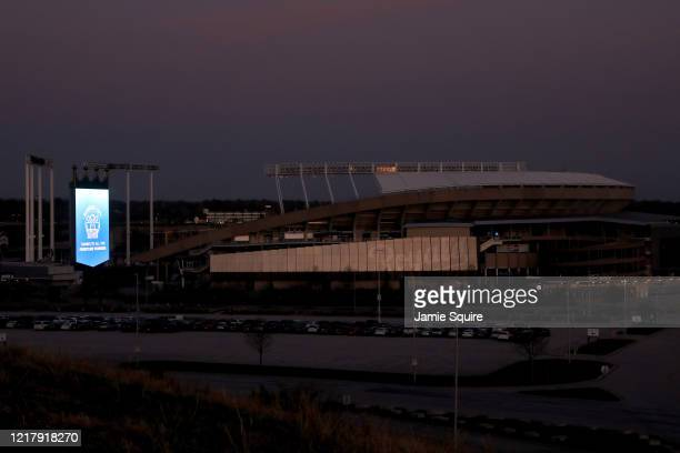 Kauffman Stadium is lit in blue as the Kansas City Royals display the LightItBlue campaign logo on their digital boards on April 09 2020 in Kansas...