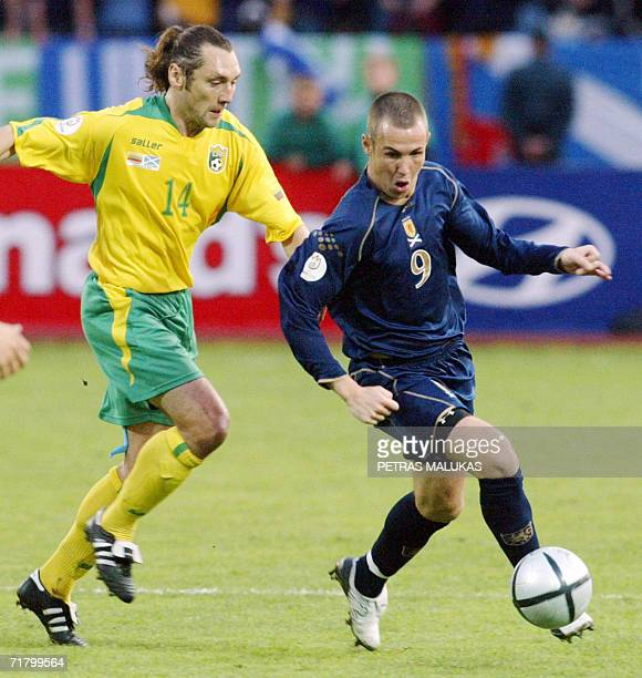 Scotland's Kenny Miller and Lithuania's Preiksaitis Aidas run for the ball during their Euro 2008 Group B qualifying soccer match at the Darius and...