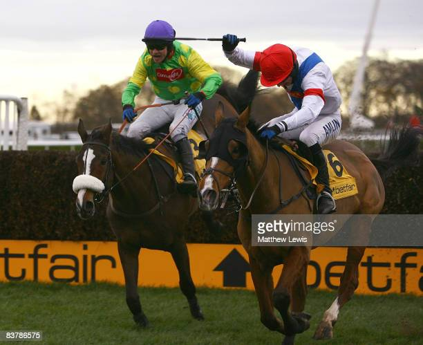 Kauto Star ridden by Sam Thomas falls at the last fence as Tamarinnbleu ridden by TJO'Brien leads in the Betfair Steeple Chase Race at Haydock Park...