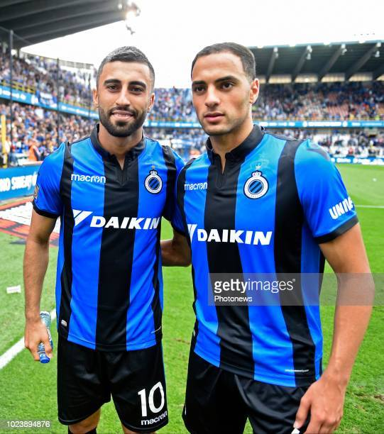 Kaveh Rezaei forward of Club Brugge and Sofyan Amrabat midfielder of Club Brugge celebrates the win with the fans during the Jupiler Pro League match...