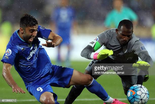 Kaveh Rezaei of Esteghlal and Majed Naser of Al Ahli in action during AFC Champions League match between Esteghlal vs Al Ahli FC at Azadi Stadium on...