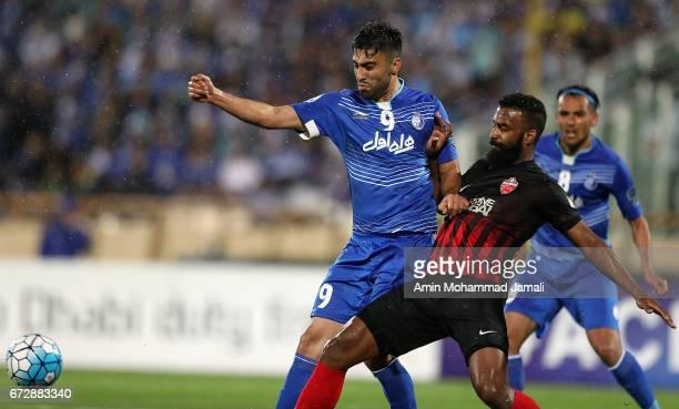 Kaveh Rezaei of Esteghlal and Salmin Khamis of Al Ahli in action during AFC Champions League match between Esteghlal vs Al Ahli FC at Azadi Stadium...