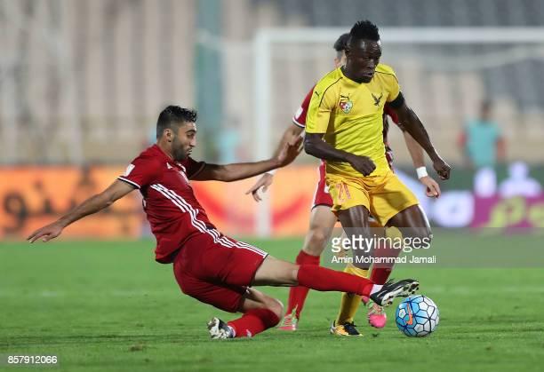 Kaveh Rezaei of Iran and Ortega Djene in action during the international friendly match between Iran and Togo at Azadi Stadium on October 5 2017 in...