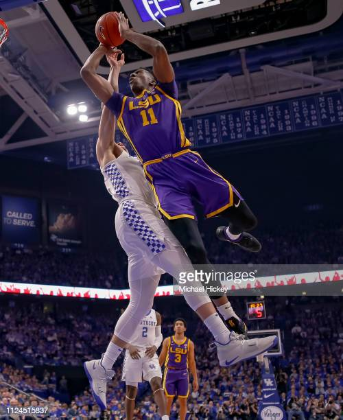 Kavell BigbyWilliams of the LSU Tigers goes up to shoot against Reid Travis of the Kentucky Wildcats during the first half of action at Rupp Arena on...