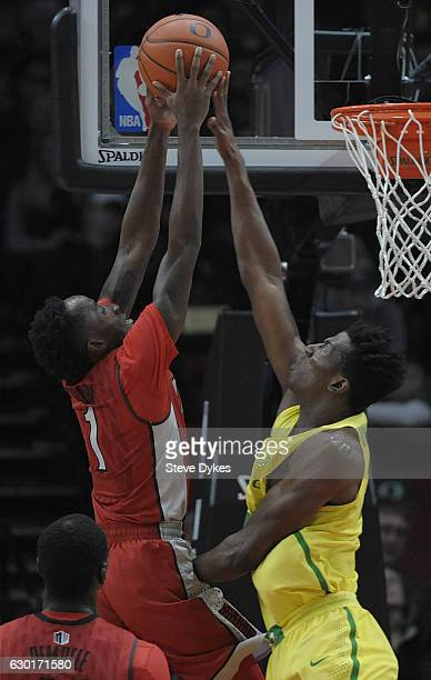 Kavell BigbyWilliams of the Oregon Ducks blocks the shot of Kris Clyburn of the UNLV Rebels during the first half of the game at the Moda Center on...