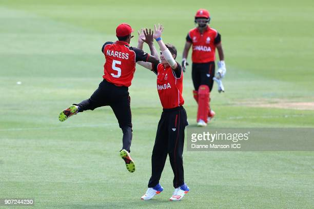 Kavian Naress and Peiter Pretorius celebrate the dismissal of Fin Ternouth of England during the ICC U19 Cricket World Cup match between England and...