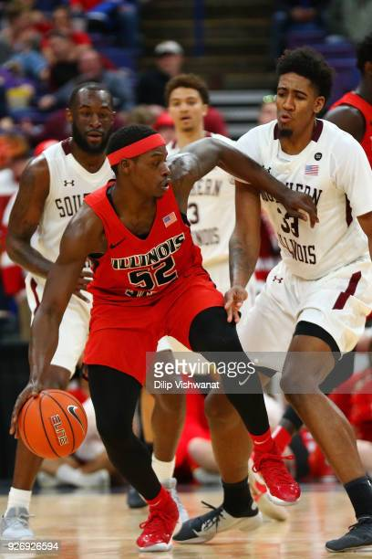 Kavion Pippen of the Southern Illinois Salukis defends against Milik Yarbrough of the Illinois State Redbirds during the Missouri Valley Conference...