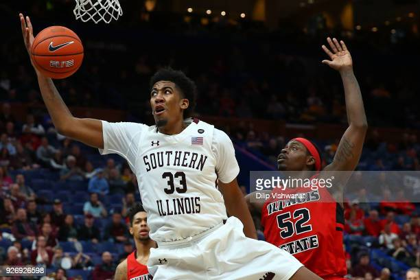 Kavion Pippen of the Southern Illinois Salukis looks to pull down a rebound against Milik Yarbrough of the Illinois State Redbirds during the...