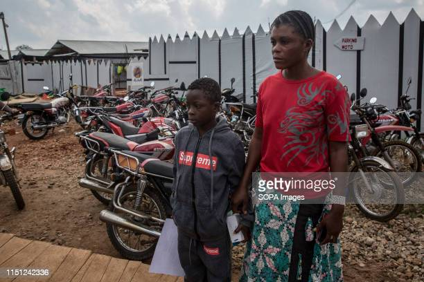 Kavira Made stands with her 8yearold son Prince after being declared Ebolafree and released from the Ebola treatment centre in Beni eastern...