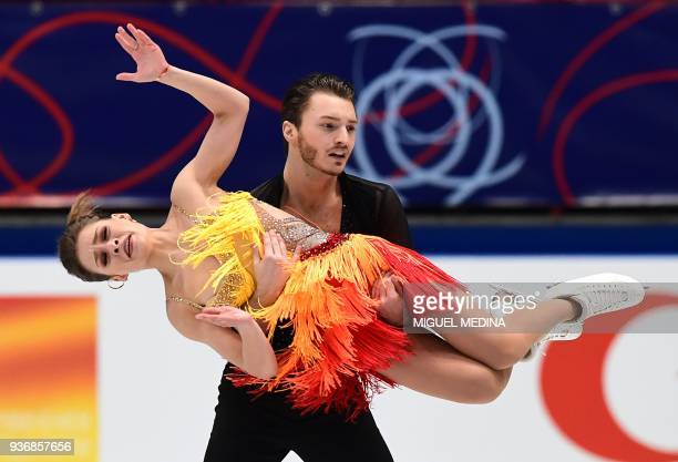 Kavita Lorenz and Joti Polizoakis from Germany perform on March 23 2018 during the Ice DanceShort Dance program at the Milano World Figure Skating...