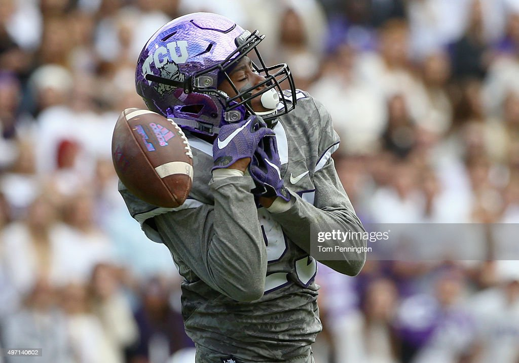 4028d6541 KaVontae Turpin  25 of the TCU Horned Frogs drops a punt return against the  Kansas