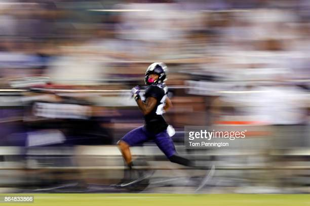 KaVontae Turpin of the TCU Horned Frogs runs a 90 yard punt return for a touchdown against the Kansas Jayhawks in the second half at Amon G Carter...
