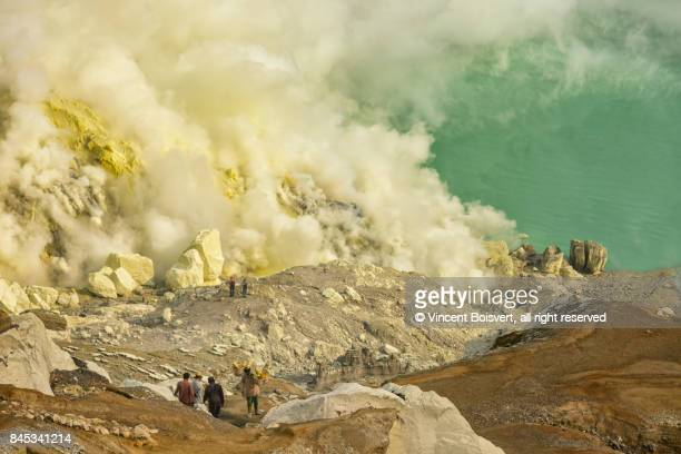 kawa ijen workers - sulfuric acid stock photos and pictures