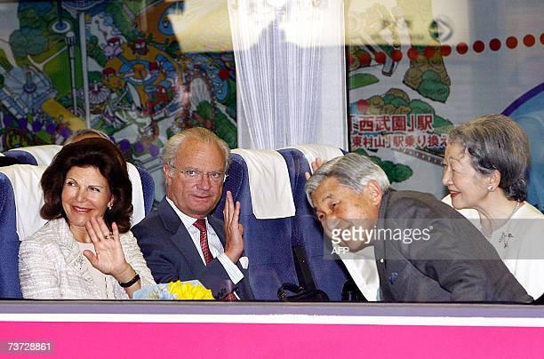 Japanese Emperor Akihito Swedish King Carl XVI Gustaf Queen Silvia and Empress Michiko wave to wellwishers seeing them off at Hon Kawagoe Station...