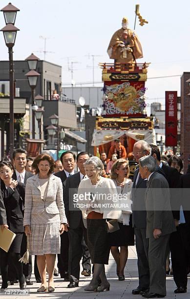 Swedish King Carl Gustaf XVI and Queen Silvia walk with Japanese Emperor Akihito and Empress Michiko while visiting Kawagoe some 30kms outside Tokyo...