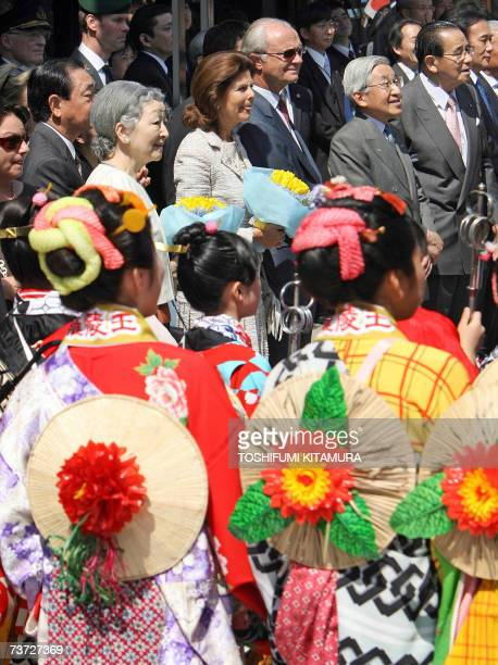 Swedish King Carl Gustaf XVI and Queen Silvia watch festival floats with Japanese Emperor Akihito and Empress Michiko during a visit to the city of...