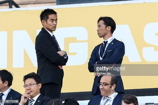 Kawaguchi Yoshikatsu and Fujida Toshiya watch the game during the AFC Asian Cup final match between Japan and Qatar at Zayed Sports City Stadium on...