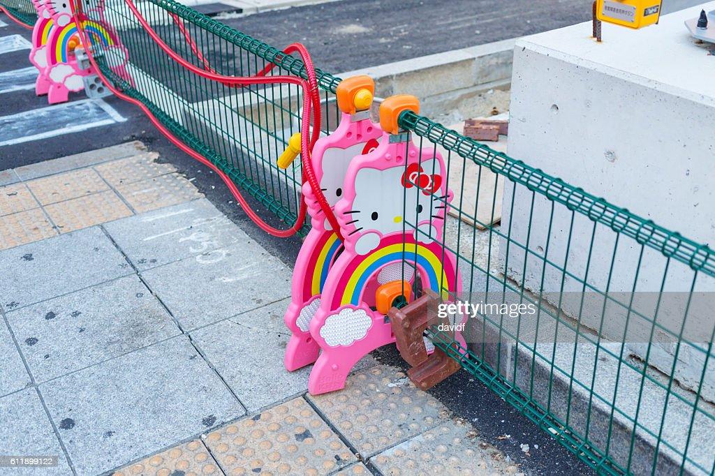 Kawaii Hello Kitty Road Works Barricades in Osaka, Japan : Stock Photo
