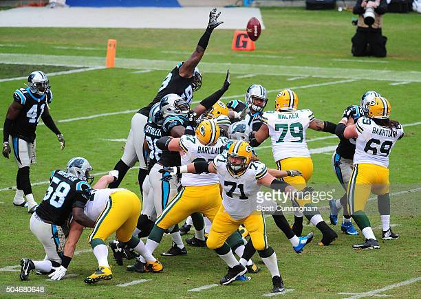 Kawann Short of the Carolina Panthers attempts to block a kick against the Green Bay Packers at Bank Of America Stadium on November 8 2015 in...