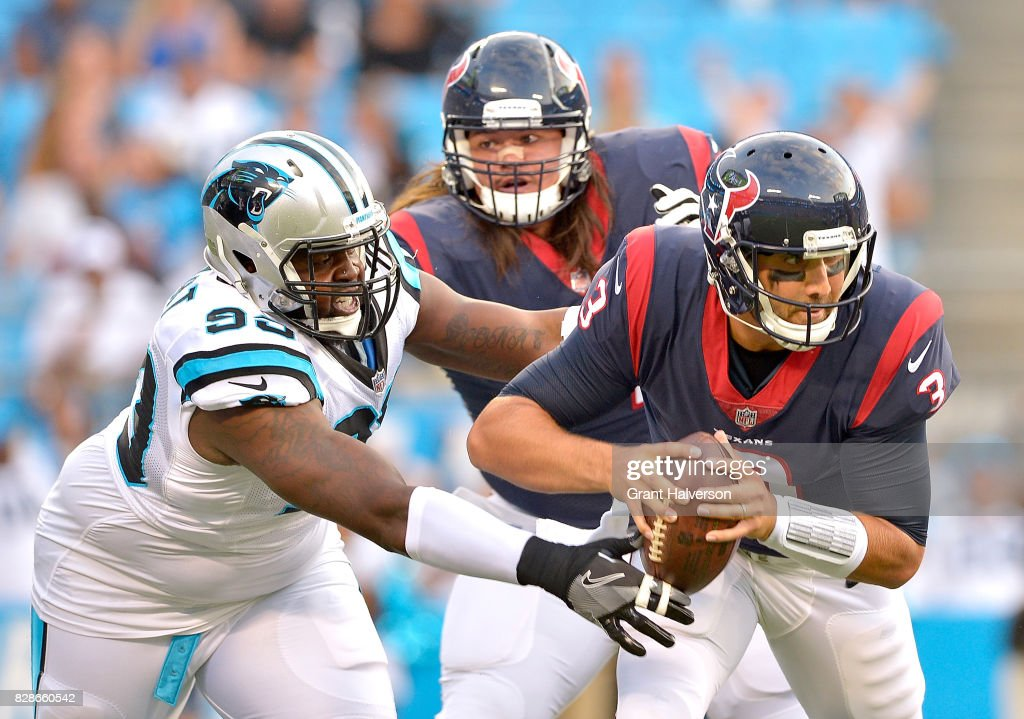 Kawann Short #99 of the Carolina Panthers pressures Tom Savage #3 of the Houston Texans during the preseason at Bank of America Stadium on August 9, 2017 in Charlotte, North Carolina.