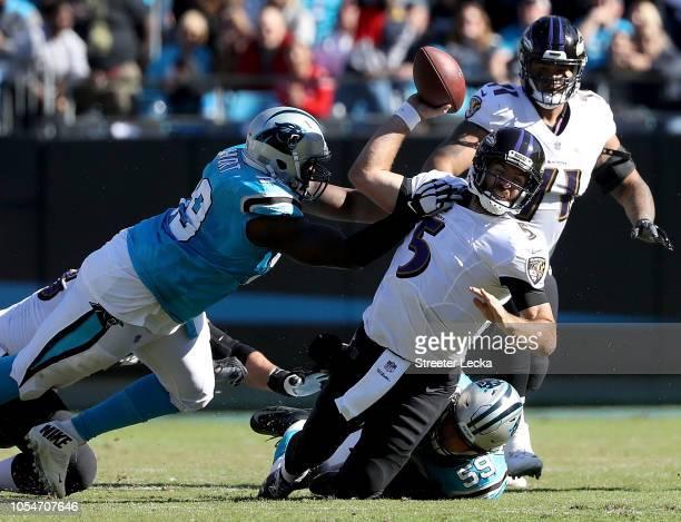 Kawann Short of the Carolina Panthers sacks Joe Flacco of the Baltimore Ravens in the third quarter during their game at Bank of America Stadium on...
