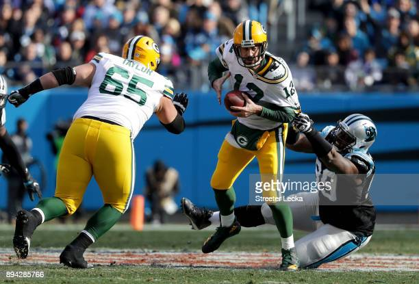 Kawann Short of the Carolina Panthers tackles Aaron Rodgers of the Green Bay Packers in the second quarter during their game at Bank of America...