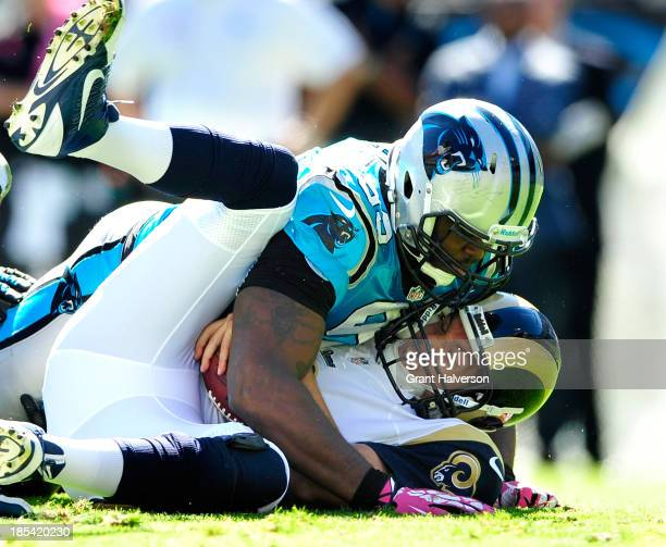Kawann Short of the Carolina Panthers tackles quarterback Sam Bradford of the St Louis Rams during play at Bank of America Stadium on October 20 2013...