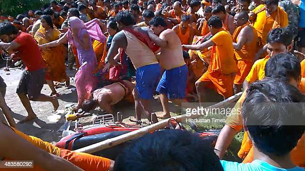 Kawariya pilgrims rush for safer places after a stampede near Baidyanath Shiva temple on August 10 2015 in Deoghar India At least 11 died and 50...
