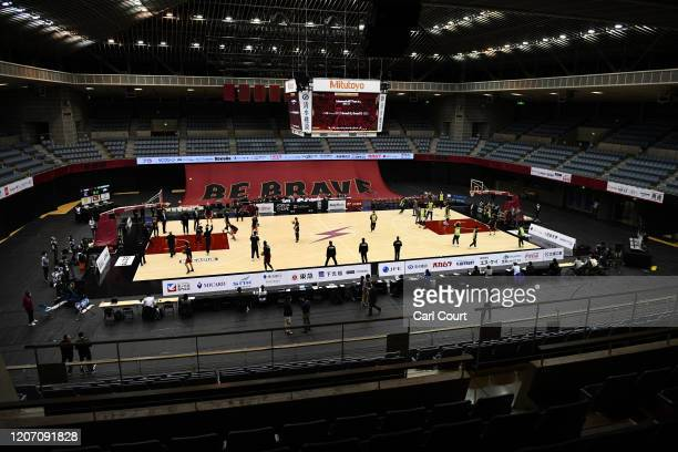 Kawasaki Brave Thunders and Levanga Hokkaido players warm up for their Japan B.League basketball match that has been held behind closed doors at...