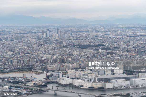 kawasaki city in kanagawa prefecture and ota ward in tokyo in japan daytime aerial view from airplane - 川崎市 ストックフォトと画像