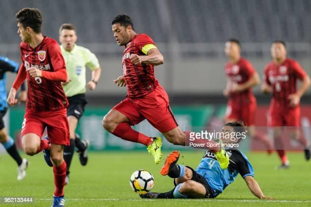 Kawasaki defender Igawa Yusuke plays against Shanghai FC Forward Givanildo Vieira de Sousa during the AFC Champions League 2018 Group Stage F Match...