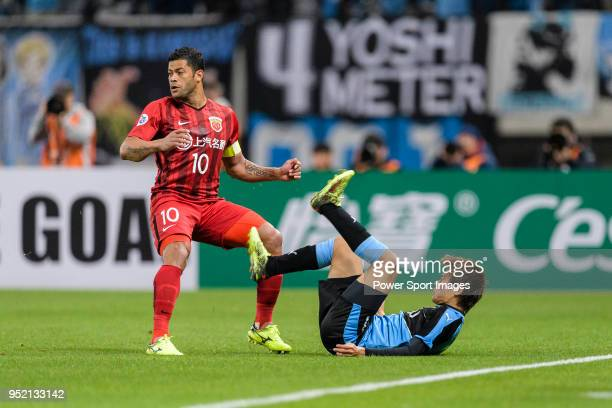 Kawasaki defender Kurumaya Shintaro trips up with Shanghai FC Forward Givanildo Vieira de Sousa during the AFC Champions League 2018 Group Stage F...