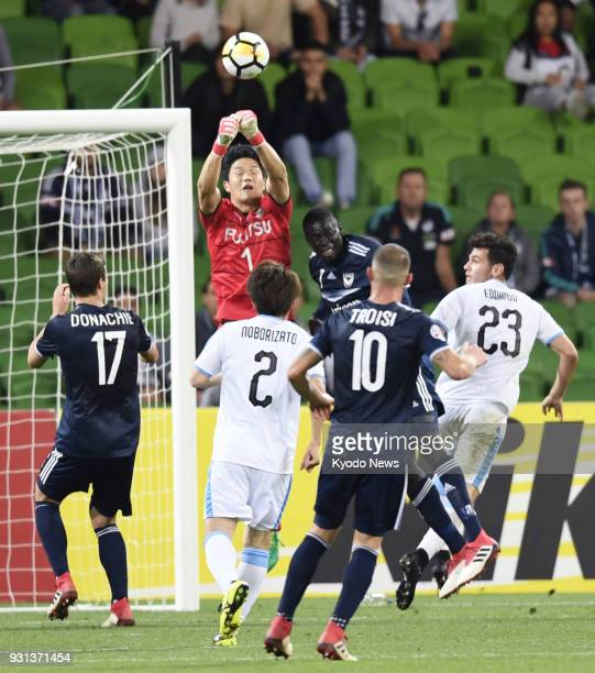 Kawasaki Frontale goalkeeper Jung Sung Ryong punches the ball during the second half of an Asian Champions League groupstage match away to Melbourne...