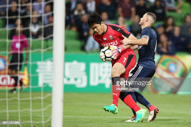 Kawasaki Frontale Goalkeeper Jung Sungryong saves a goal James Troisi of the Victory during the AFC Asian Champions League match between the...