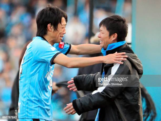 Kawasaki Frontale head coach Toru Oniki and Kengo Nakamura celebrate their side's J1 Champions after the JLeague J1 match between Kawasaki Frontale...