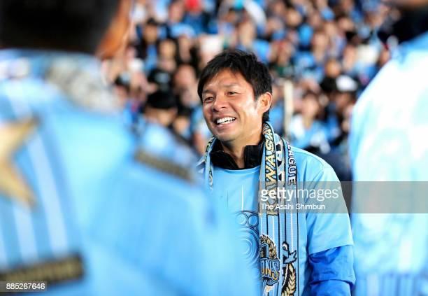Kawasaki Frontale head coach Toru Oniki celebrates his side's J1 Champions after the JLeague J1 match between Kawasaki Frontale and Omiya Ardija at...