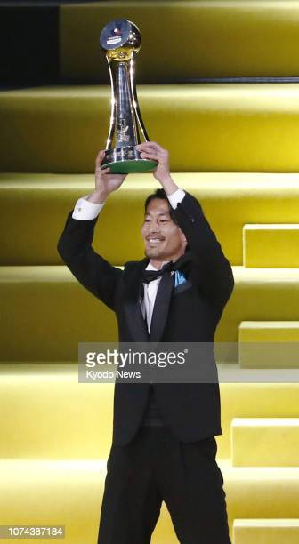 Kawasaki Frontale midfielder Akihiro Ienaga holds up his trophy after being named the JLeague's Player of the Year during a ceremony in Yokohama on...