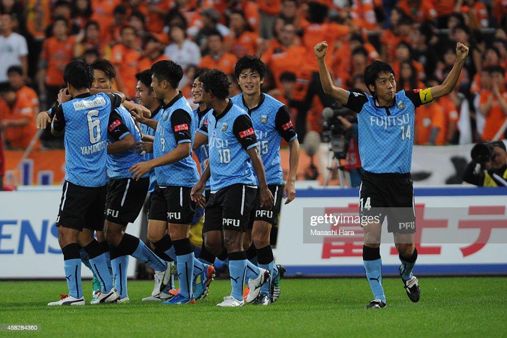 Kawasaki Frontale players celebrate the first goal during the J.League match between Kawasaki Frontale and Shimzu S-Pulse at Todoroki Stadium on November 2, 2014 in Kawasaki, Kanagawa, Japan.