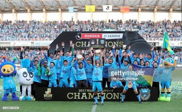 Kawasaki Frontale players celebrate the J1 Champions after the JLeague J1 match between Kawasaki Frontale and Omiya Ardija at Todoroki Stadium on...