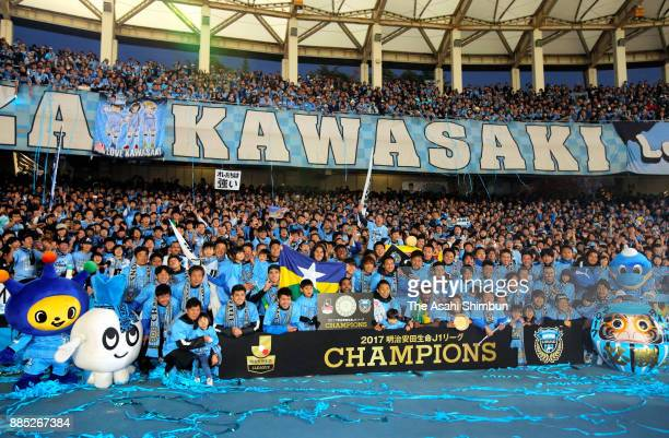Kawasaki Frontale players celebrate the J1 Champions with supporters after the JLeague J1 match between Kawasaki Frontale and Omiya Ardija at...