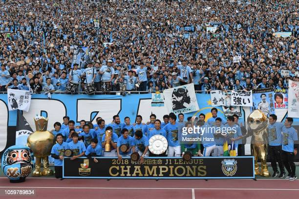 Kawasaki Frontale players celebrate the J1 Season Champions with supportres after the JLeague J1 match between Cerezo Osaka and Kawasaki Frontale at...
