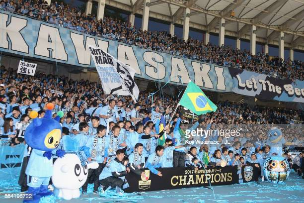 Kawasaki Frontale players celebrate the JLeague Champions with supporters after the JLeague J1 match between Kawasaki Frontale and Omiya Ardija at...