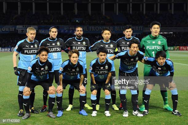 Kawasaki Frontale players line up for the team photos prior to the AFC Champions League Group F match between Kawasaki Frontale and Shanghai SIPG at...