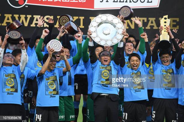 Kawasaki Frontale president Yoshihiro Warashina lifts the tropfy to celebrate with players after the JLeague J1 match between Kawasaki Frontale and...
