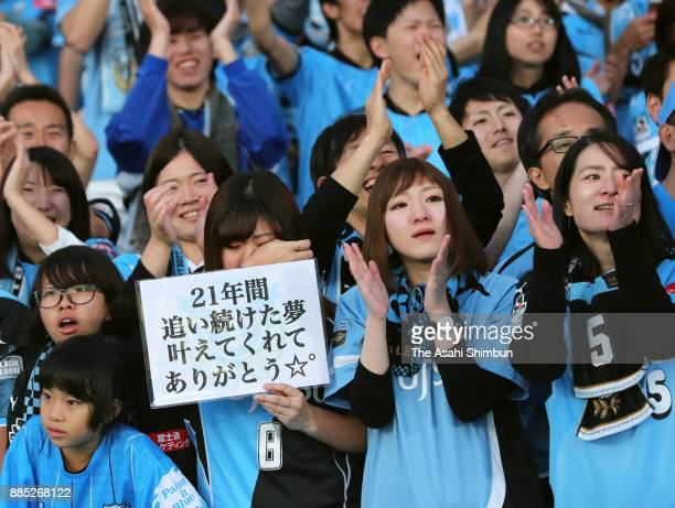 Kawasaki Frontale supporters celebrate their team's J1 Champions after the JLeague J1 match between Kawasaki Frontale and Omiya Ardija at Todoroki...