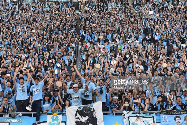 Kawasaki Frontale supporters celebrate their team's J1 Season Champions after the JLeague J1 match between Cerezo Osaka and Kawasaki Frontale at...